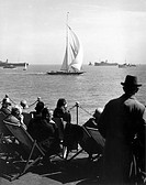 Yachting at Southend, Essex, 27 May 1931  Spectators watch the Shamrock V  Photograph by Harold Tomlin