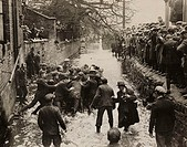 A photograph of players fighting for the ball in Henmore Brook during the Shrovetide football match in Ashbourne, Derbyshire, in 1932  Shrovetide foot...