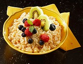 Rice pudding with berries and kiwi fruits