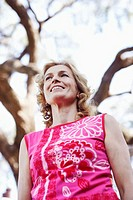 Low angle view of a mature woman smiling and looking away
