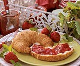Croissant with butter and strawberry jam Not available in FR
