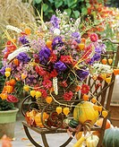 Autumnal arrangement of flowers and ornamental gourds