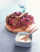 Wholemeal baguette with red cabbage and meatballs