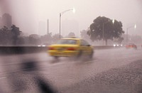 Cars traveling through a thunderstorm and traffic, Chicago, Illinois