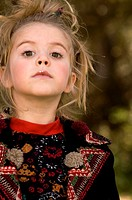Portrait of young blonde girl outside (thumbnail)