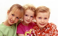 Three young children sitting happily (thumbnail)
