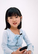 Portrait of little girl with mobile phone headset