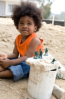 Portrait of little boy playing outdoors