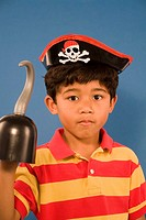 Portrait of Hispanic boy dressed like pirate