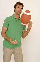 Portrait of a man tossing a football