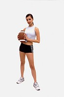 Caucasian female holding football