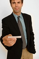 Portrait of a business man offering his business card