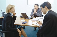 Professional couple sitting in meeting with sales executive