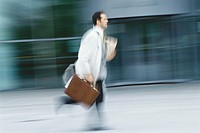 Businessman running with briefcase