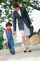 Businesswoman walking with son