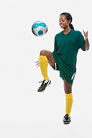 Footballer playing keepy uppy