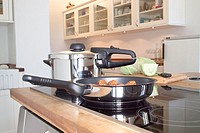frying pan and other saucepan or pot on stove in kitchen