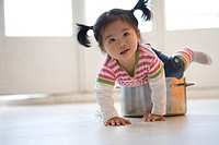portrait of asian girl playing on floor