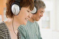 Couple wearing headphones