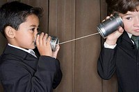 Young Businessmen Using Tin Can Telephone