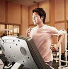 Young Man Jogging on a Treadmill