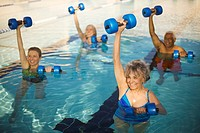 Seniors Exercising in Swimming Pool