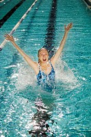 Senior Woman Jumping in Swimming Pool