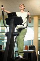 Woman Exercising on an Elliptical Trainer