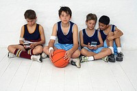 Basketball Team Sitting on the Floor
