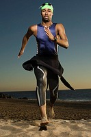 Triathlete Running on Beach