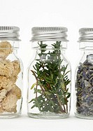 Vials containing herbs and dried flowers