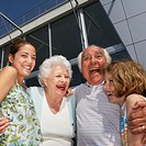Grandparents Hugging Their Grandchildren (thumbnail)