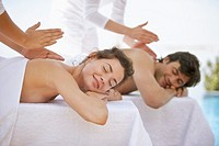 Man and Woman Receiving a Massage