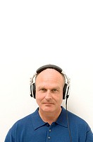 Portrait of a senior man listening to music on headphones