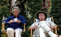 Close-up of a senior couple sitting in chairs