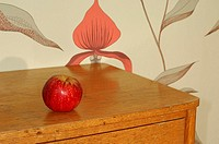 Close-up of an apple on a drawer