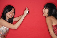 Woman taking a picture of her friend