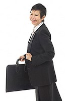 Businesswoman with briefcase, looking away, smiling