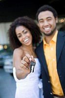 Couple showing off new car keys