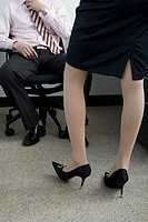 Businesswoman wearing high heels in office