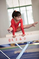 Young girl practicing gymnastics