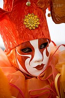Close-up of a person wearing a masquerade mask, Venice, Italy