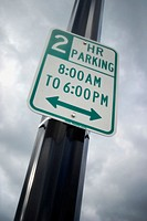 Traffic sign on a metal pole reading, '2 Hour Parking'