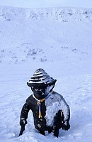 A black statue covered with snow during winter