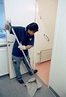 Thaiwoman cleaning at a hospital in Stockholm 2005
