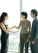 Mature professional woman shaking hands with female client