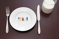 still life of five capsules on plate