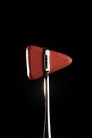 Reflex hammer against black background, close-up