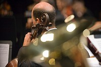 Cellist in symphony orchestra during performance selective focus