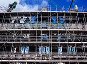 Scaffolding on exterior of Victorian building, low angle view